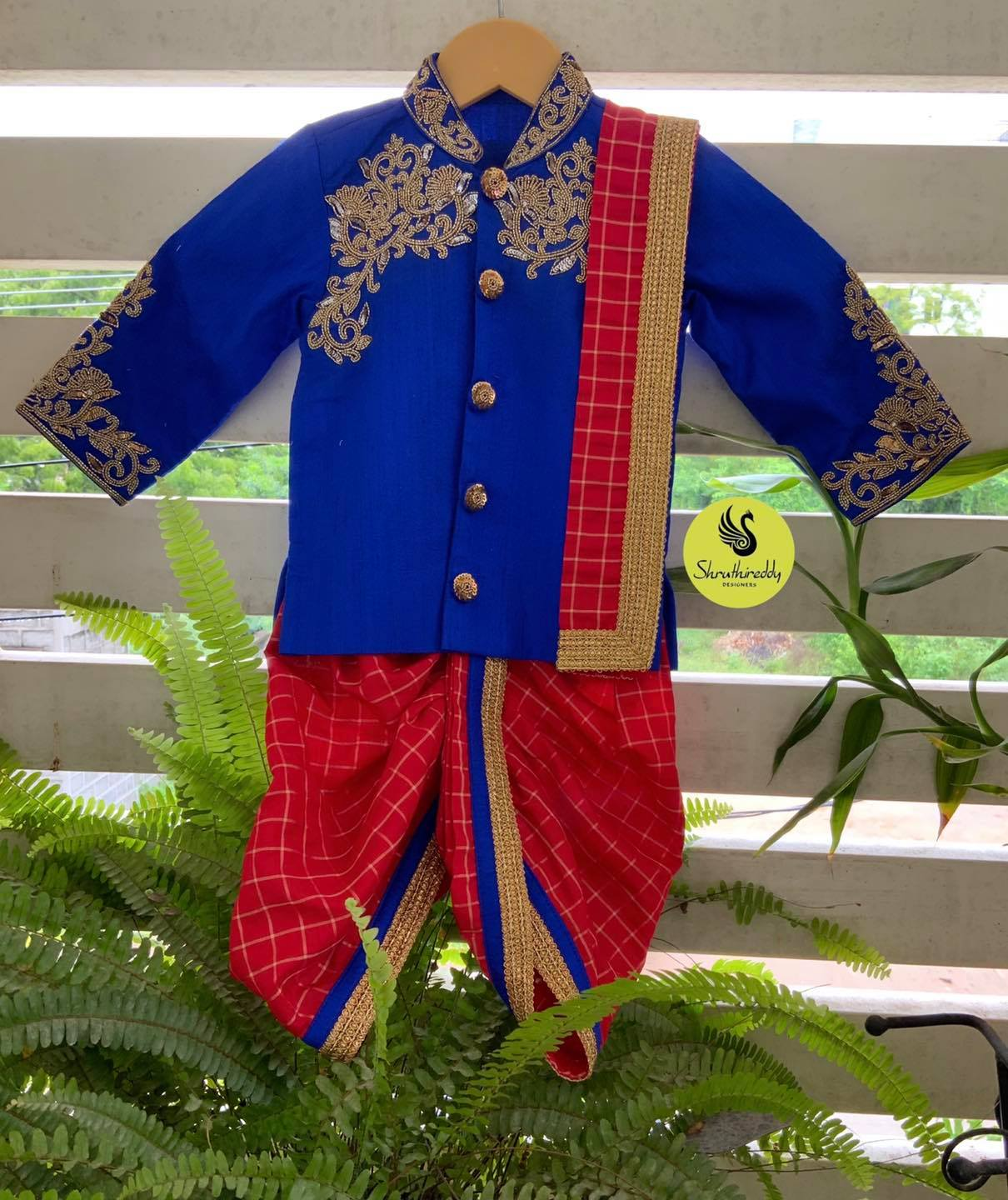 Stunning red color checked dhoti and blue kids sherwani with hand embroidery work.  2021-09-05