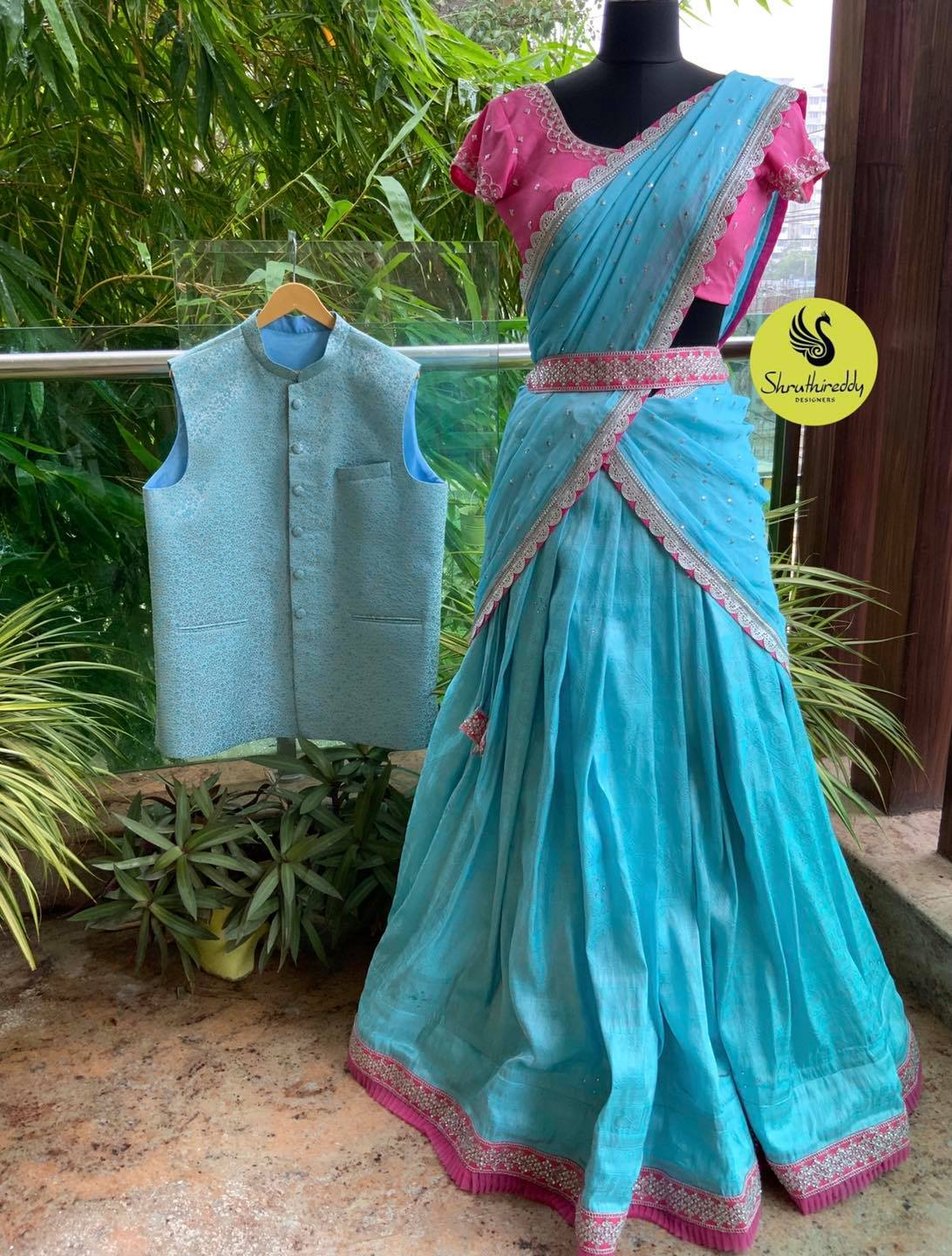 Gorgeous sky blue color lehenga and pink blouse with dupatta.  Half saree with embroidery waist belt.  2021-09-05