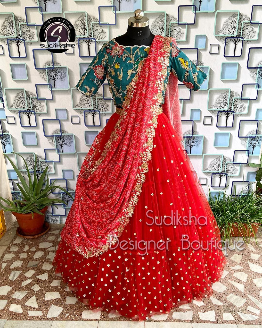 Stunning red color net or tulle lehenga and teal blue blouse with cut work dupatta. 2021-09-05