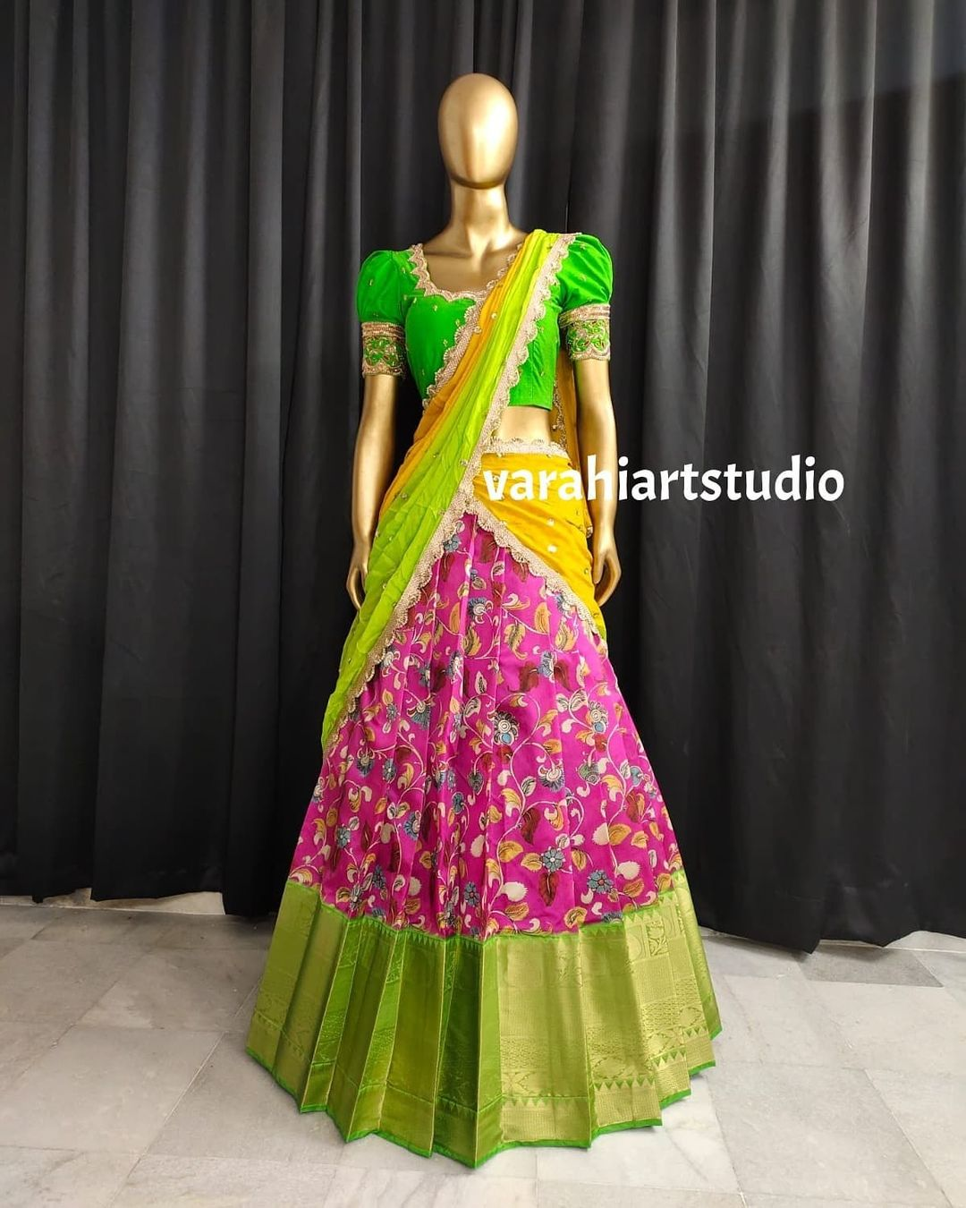 Stunning pink kalamkari kanchi pattu border lehenga and parrot green blouse with net dupatta. Blouse with maggam work. 2021-09-05