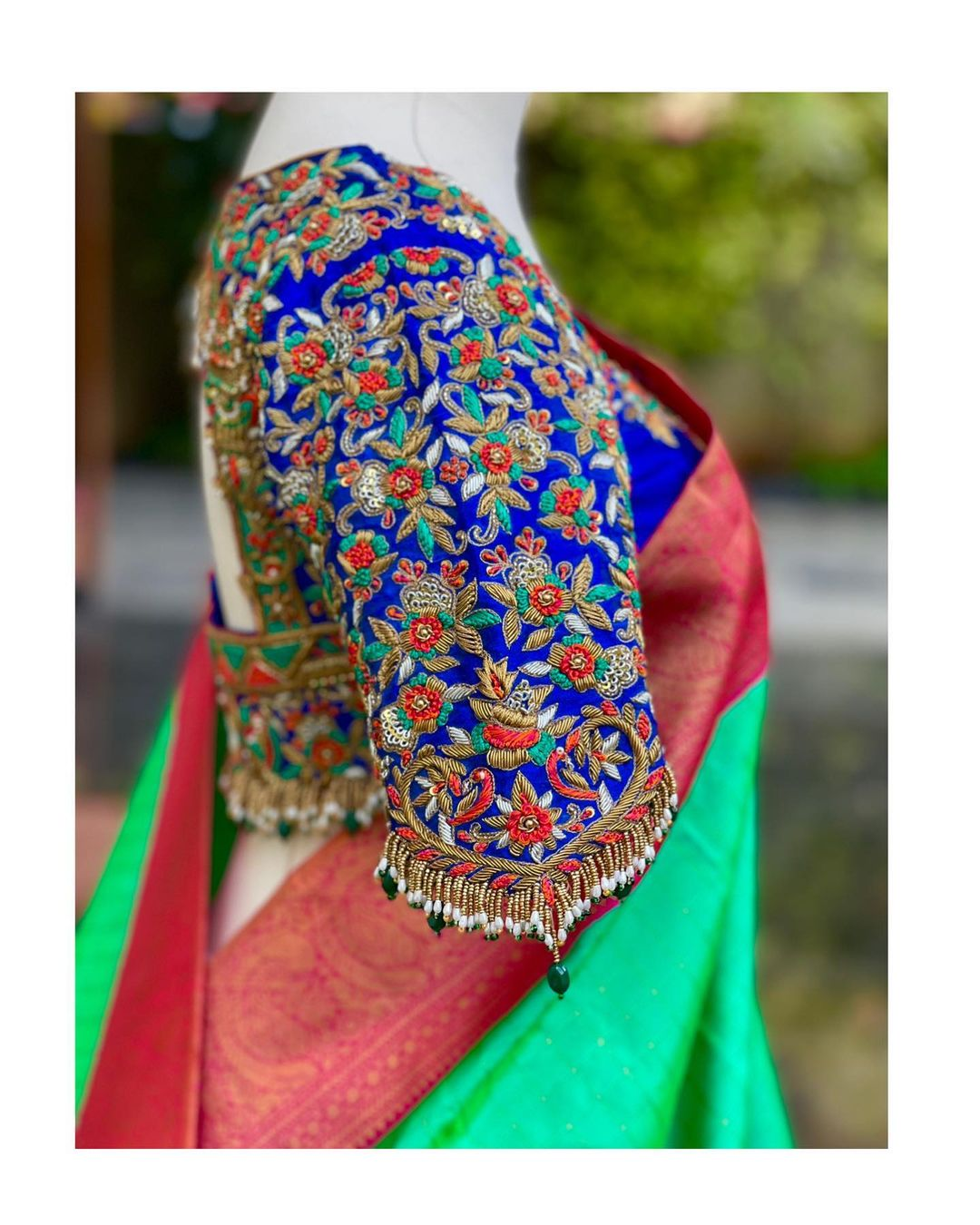 Stunning royal blue color bridal blouse with floral creeper thread maggam work.  2021-09-06