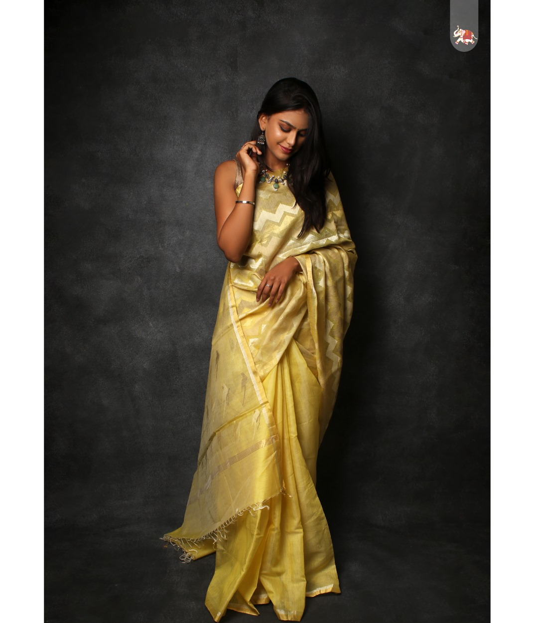 Beautiful pastel yellow half & half organza saree with parrot design in pallu is paired with fancy ready made designer blouse for a very simple yet elegant look! 2021-09-07