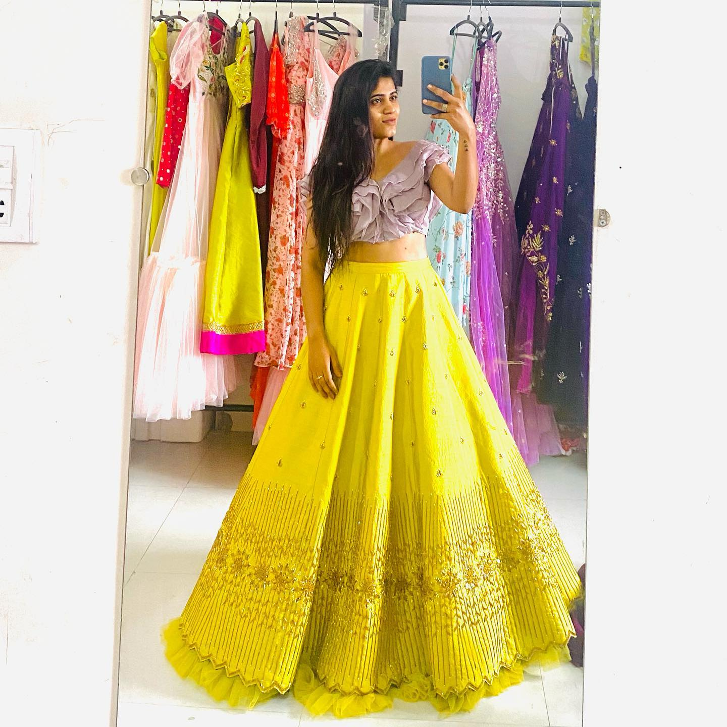 Stunning yellow color skirt and lavender ruffle crop top. Skirt with hand embroidery work.  2021-09-07