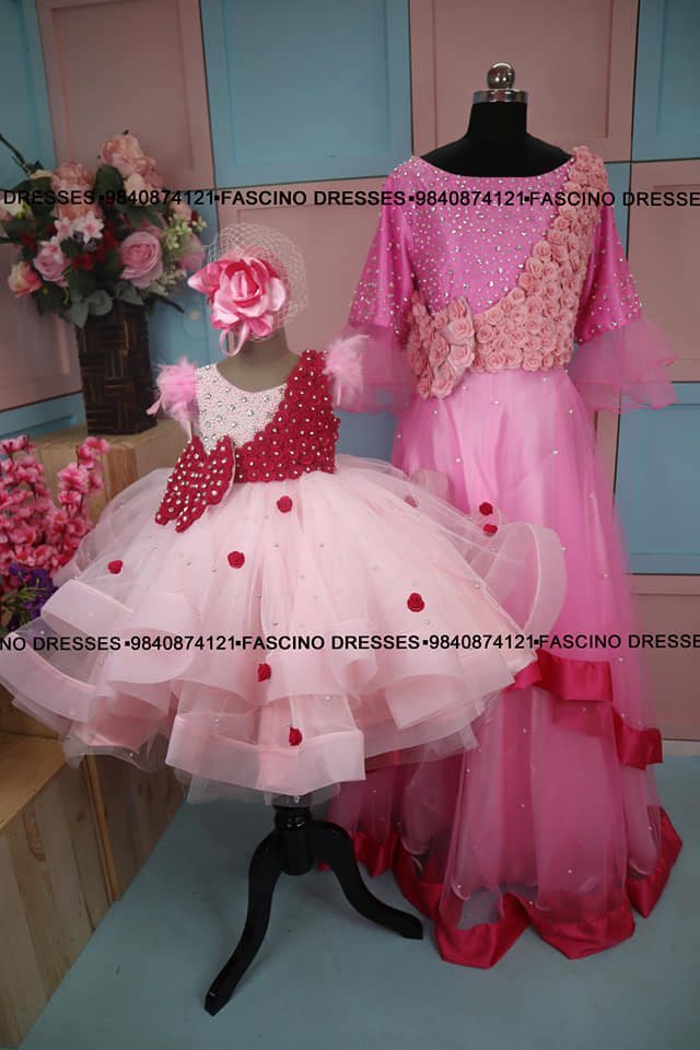 A mild pink pearl gown embellished with pearls and crystals and hot pink flowers... With a detachable ruffle trail paired with momma dress .  Wats app or inbox to order 9840874121. Can customize in any color / size. 2021-09-07