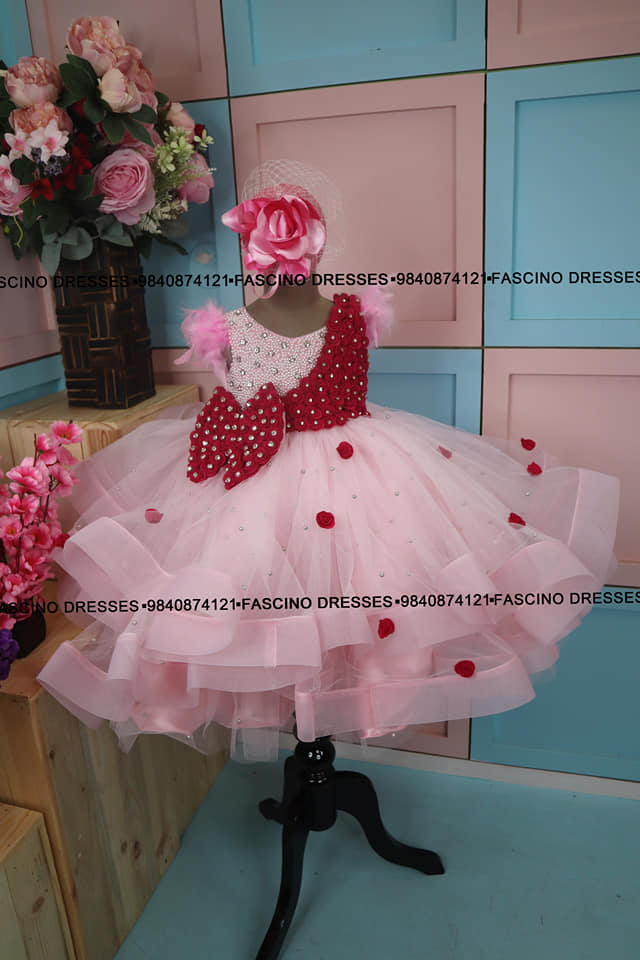 A mild pink pearl gown embellished with pearls and crystals and hot pink flowers. 2021-09-07