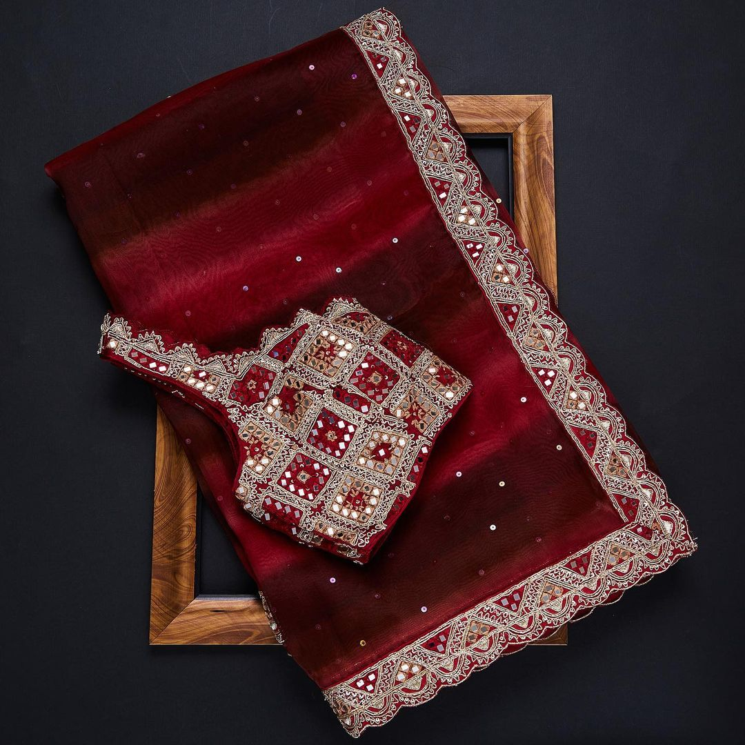 An exclusive party wear attire! This red organza saree casts a magical spell with its simple yet sophisticated look. The saree body is elegantly decorated with minimal sequins work and the border and ready to wear blouse carries a rich dose of embroideries to give a glamorous look.  — Worldwide free shipping Contact : 00919845922959 Email: Esales@samyakk.com Product Code: SF2501 2021-09-07