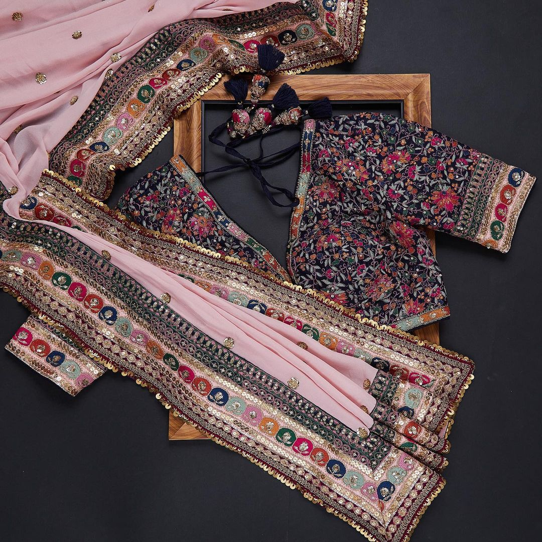 Go ethnic this festive season as you drape this saree in a pink tone. The saree is detailed with traditional motifs on the body and comes with brocade border which is defining its role to perfectly complement the look of an ensemble.  A curation of vibrant occasion wear with meticulous embroidery work in the shade of bright red makes an perfect ensemble. To enhance your look saree has been paired with embroidered ready-to-wear blouse!  _ Worldwide free shipping Contact : 00919845922959 Email: Esales@samyakk.com Product Code: SF3142 2021-09-07