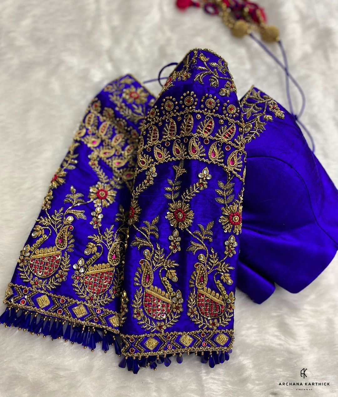 Stunning royal blue color bridal blouse with floral zardosi work. 2021-09-07