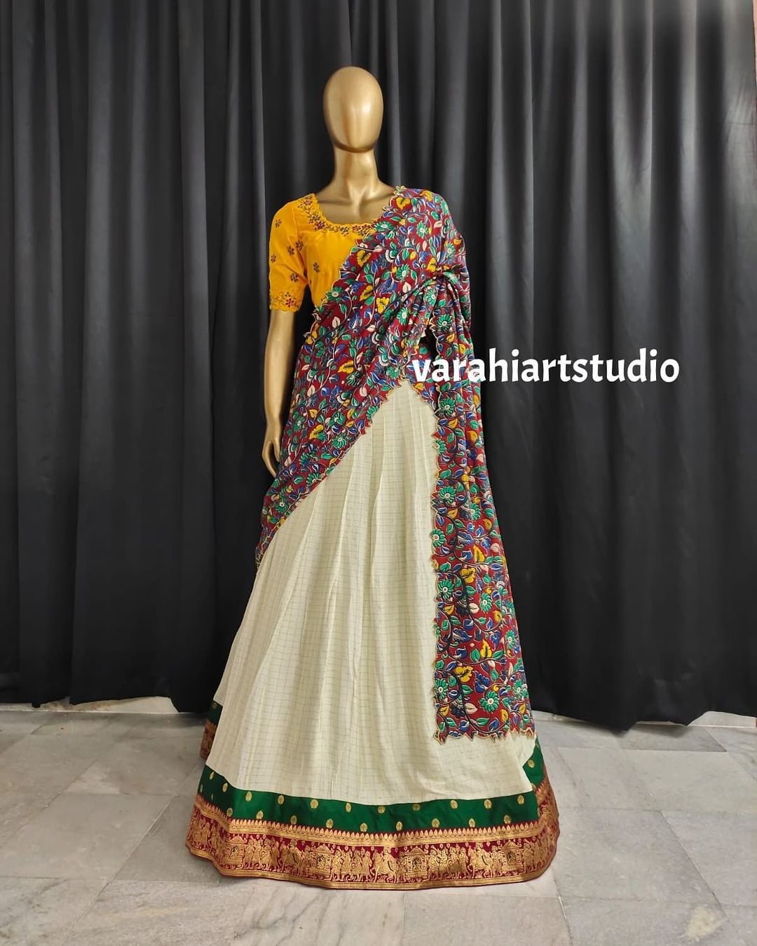 Stunning off white color pattu lehenga and yellow blouse with floral dupatta. 2021-09-07