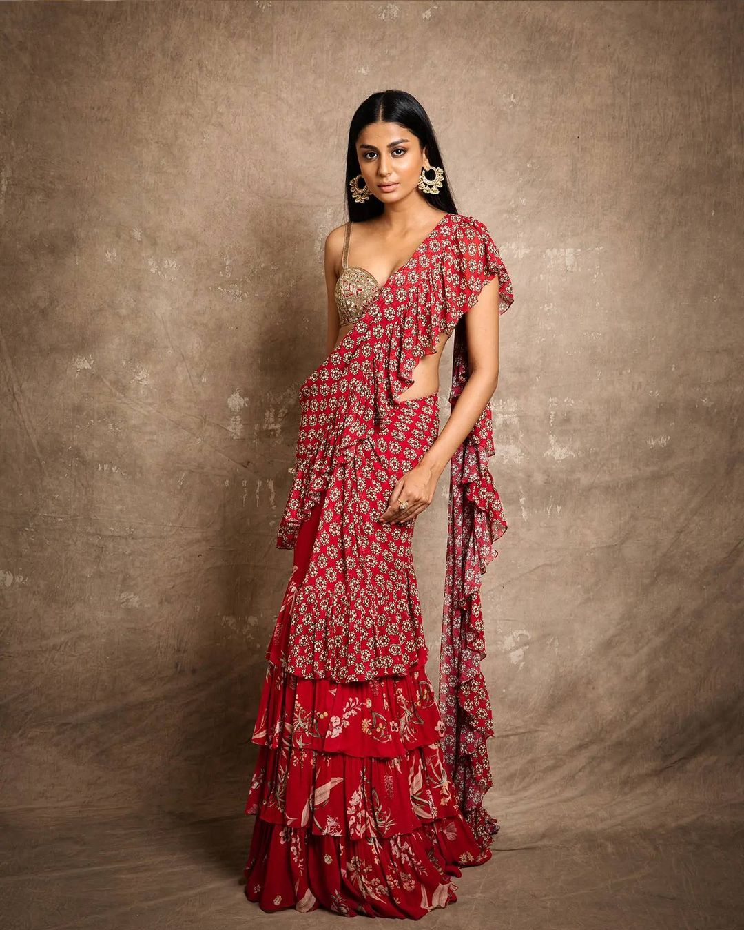 Bold & sassy cheerful yet delicate. Find your favourite for this season's demand! Red floral ruffle saree. 2021-09-07