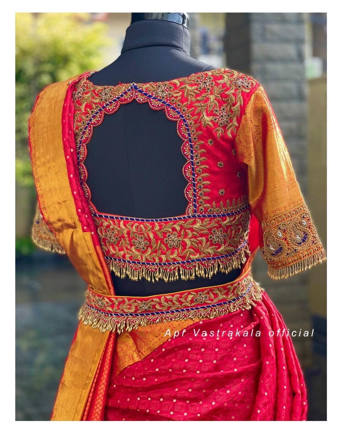 Stunning red color bridal blouse back with gold thread maggam work. 2021-09-07