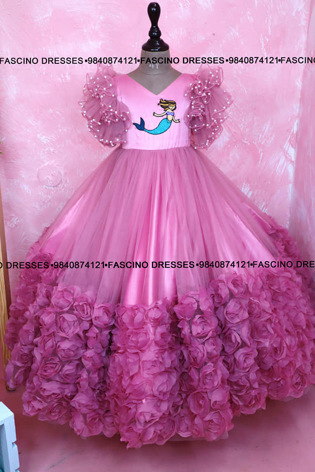 A mermaid pastel pink rosette kids ballgown from Fascino . Wats app or inbox to order 9840874121. Can customize in any colors/ size. 2021-09-08