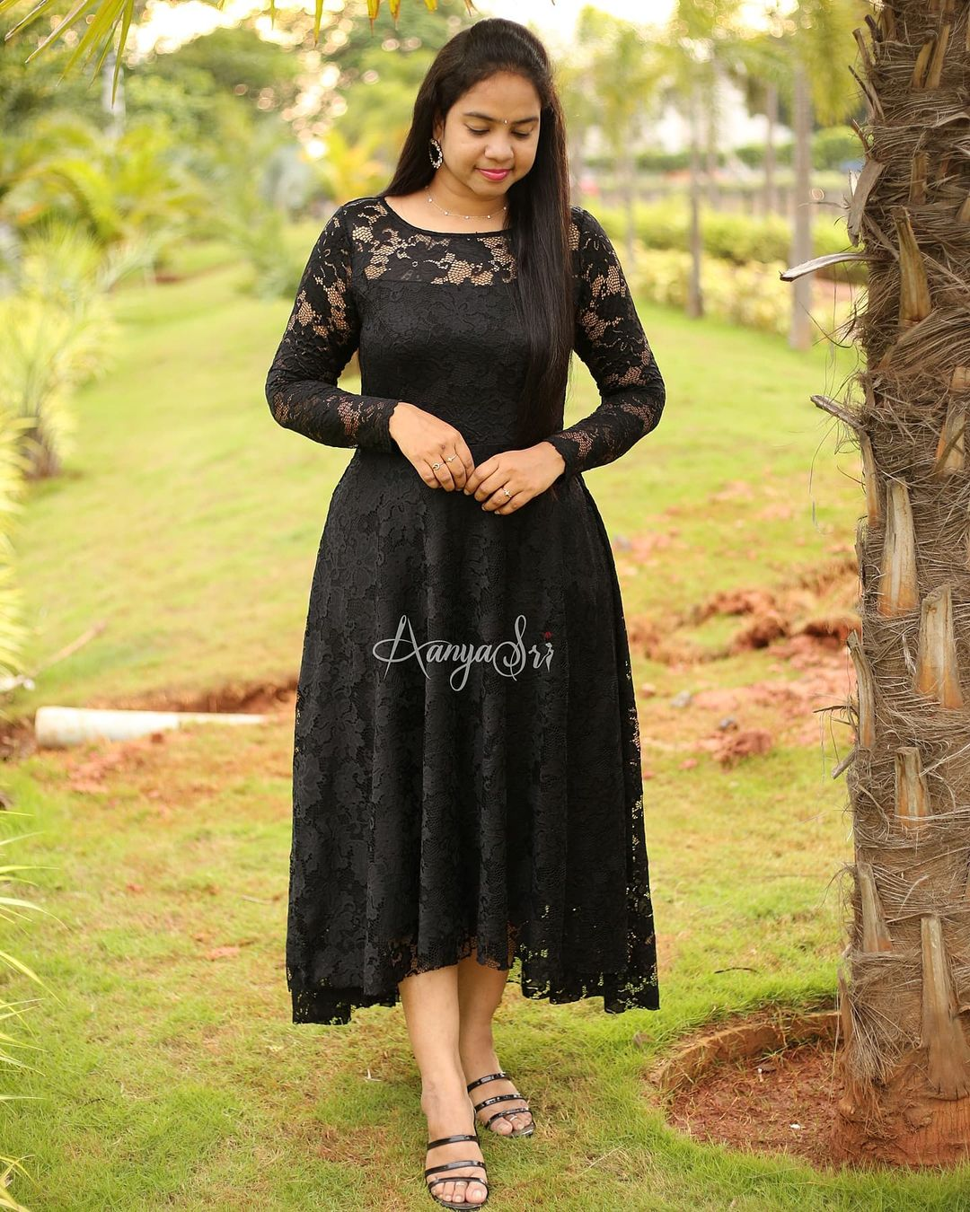Beautiful Black laced high low dress with sheer yoke and hands .This frock is made of a stretchable high quality lace fabric ! 2021-09-09