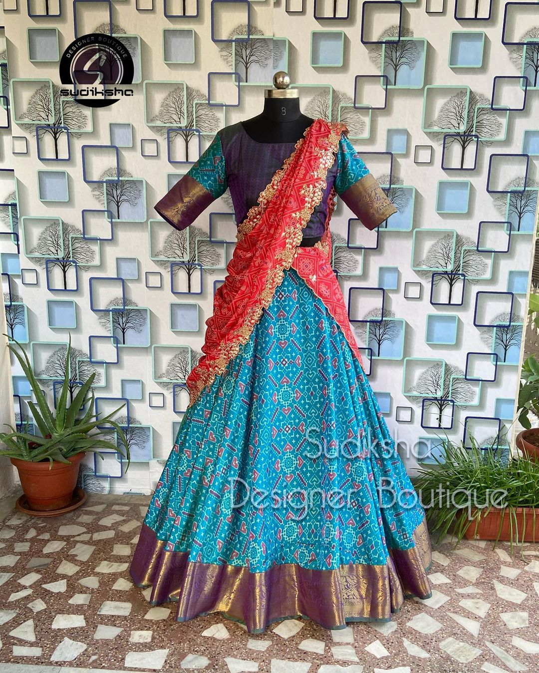Stunning teal blue color pattu boarder lehenga and blouse with red net cit work dupatta. This outfit available at Rs 5800/- 2021-09-09
