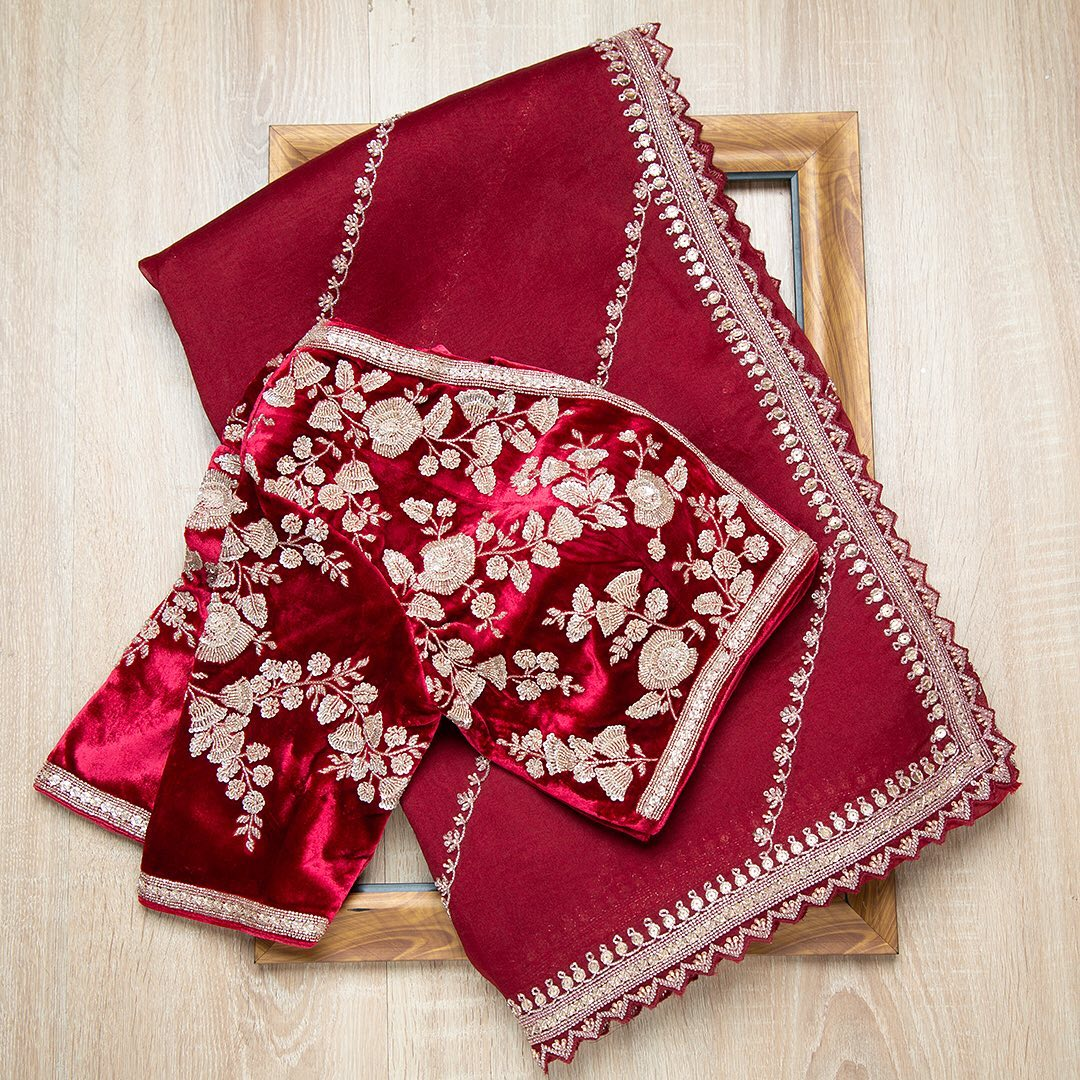 Ravishing cherry red-hued organza drape with minimal embroidery is styled with a stunning densely embroidered velvet ready blouse is sure to take the breath away!  Worldwide free shipping Contact : 00919845922959 Email: Esales@samyakk.com Product Code: SE2444  2021-09-10