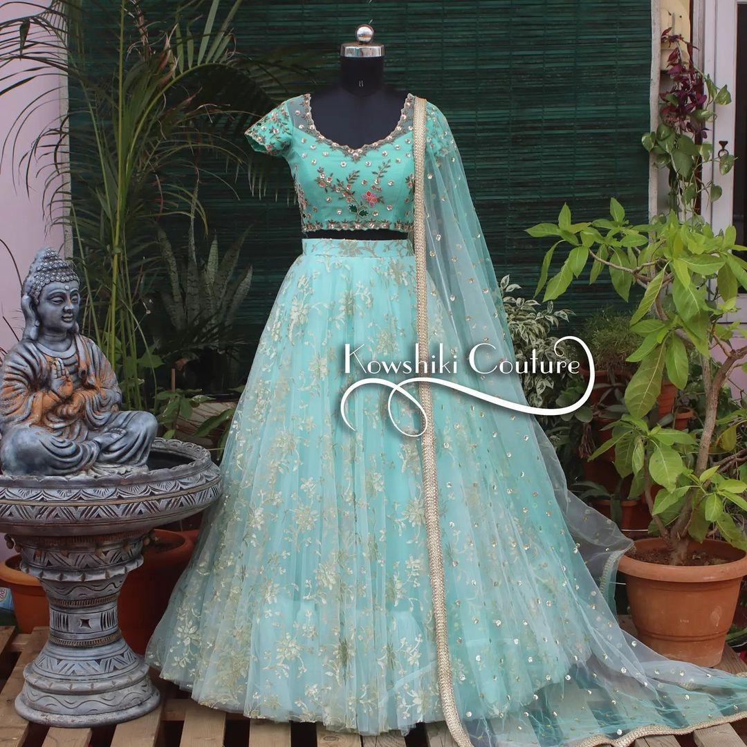 Stunning ice blue color net bridal lehenga and blouse with net dupatta.  Lehenga and blouse with hand embroiderywork.  2021-09-10