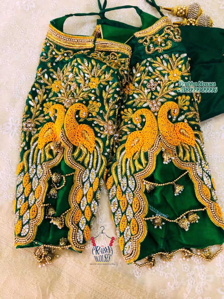 Gorgeous green color bridal blouse with peacock hand embroidery gold thread and stone maggam work.  2021-09-11