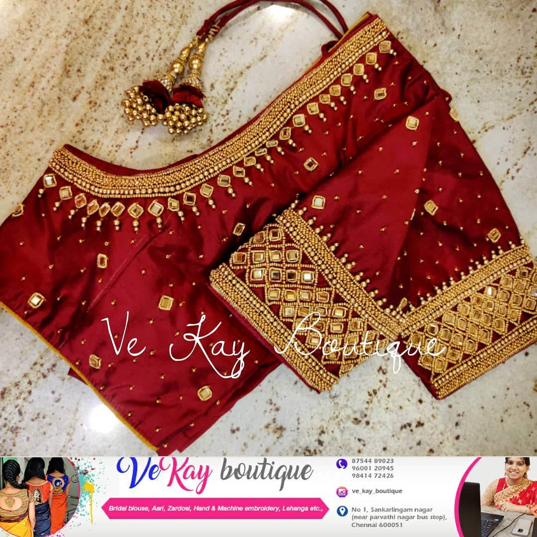 Gorgeous red color bridal blouse with bead and kundan aari work. 2021-09-11