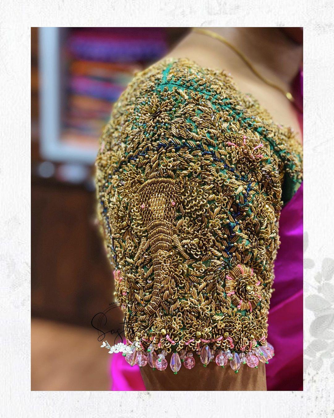 Stunning bridal blouse with Lord Vinayaka heavy maggam work. 2021-09-11