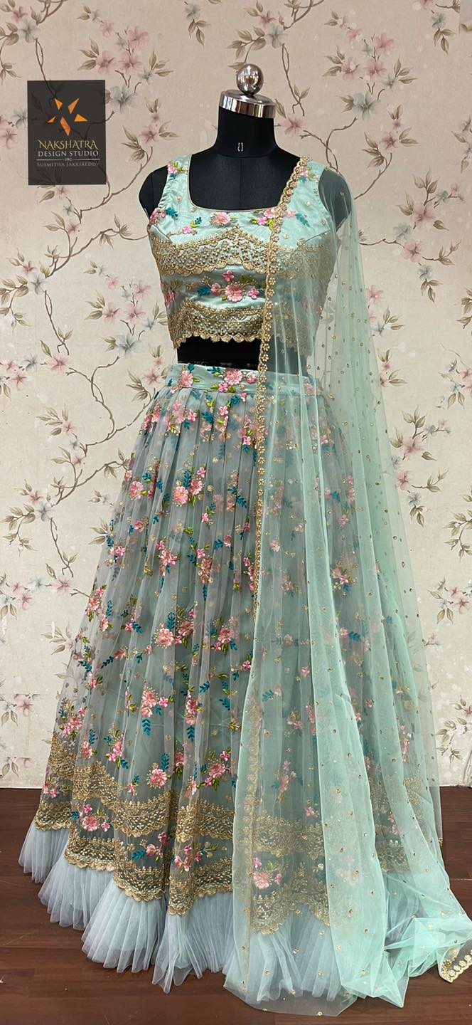 Beautiful sea green color net lehenga and sleeveless blouse with net dupatta. Lehenga and blouse with floral embroidery work.  2021-09-12