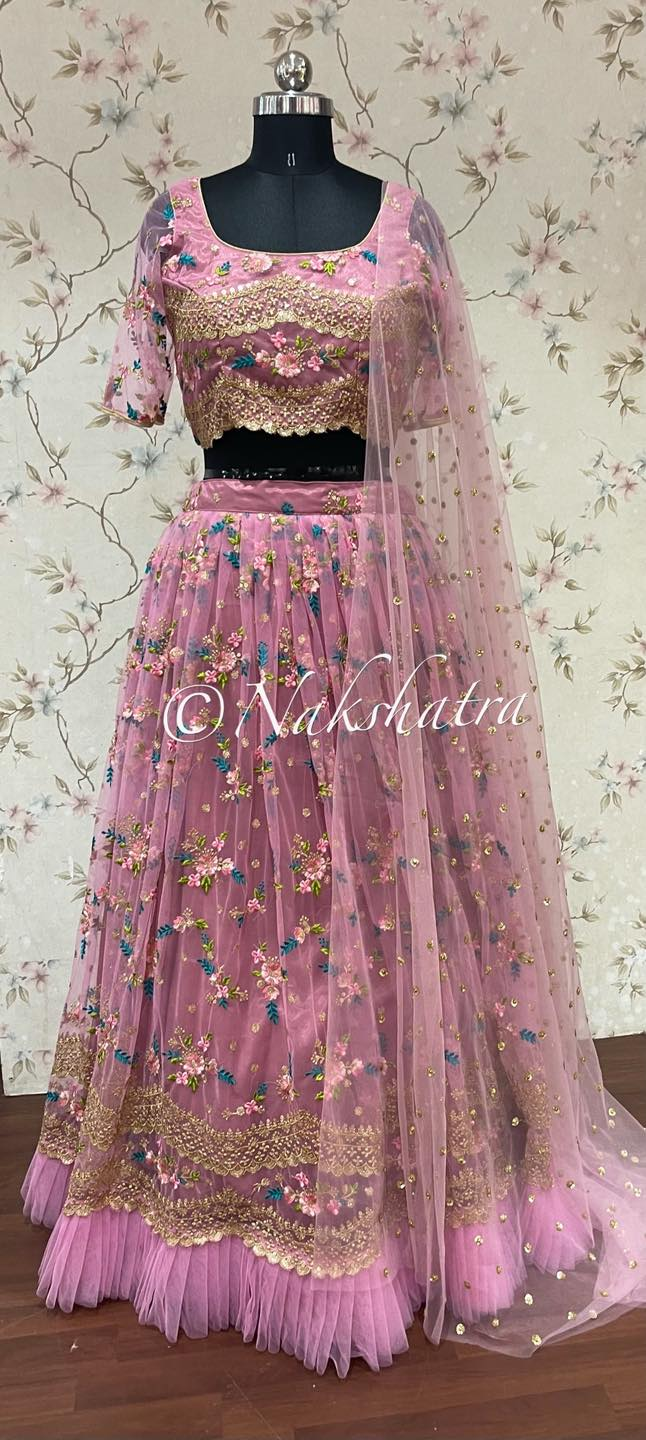 Beautiful blush pink color net lehenga and sleeveless blouse with net dupatta. Lehenga and blouse with floral embroidery work.  2021-09-12