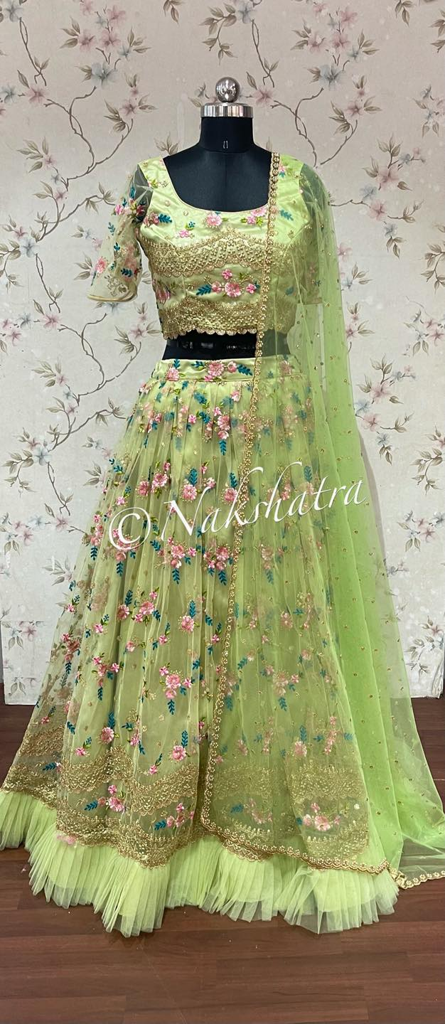 Beautiful parrot green  color net lehenga and sleeveless blouse with net dupatta. Lehenga and blouse with floral embroidery work.  2021-09-12