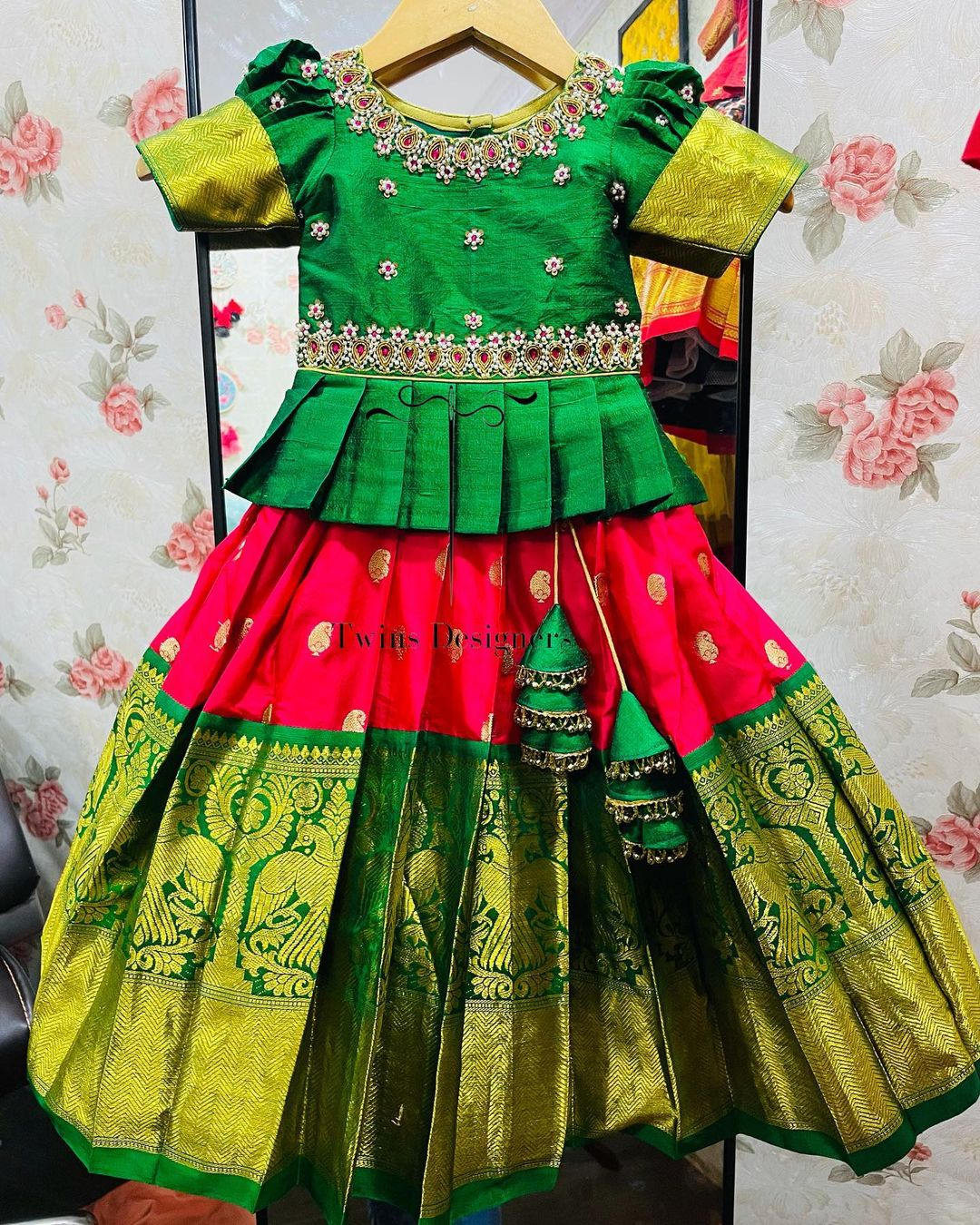 Gorgeous pink kids kanchi pattu lehenga and green long blouse. Long blouse with hand embroidery work.  2021-09-12