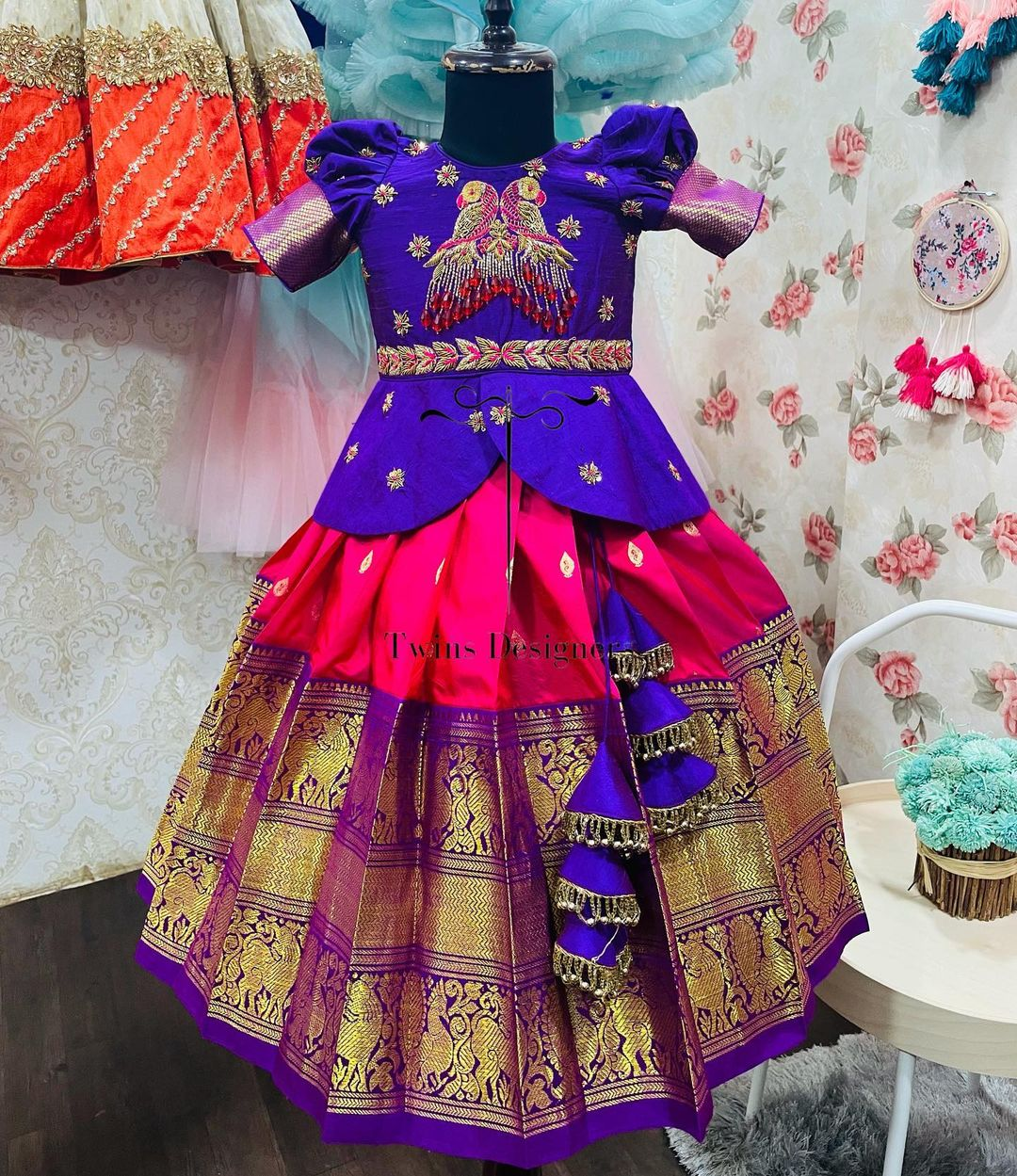 Stunning kids pink kanchi pattu lehenga and blue long blouse. Long blouse with peacock hand embroidery work.  2021-09-12