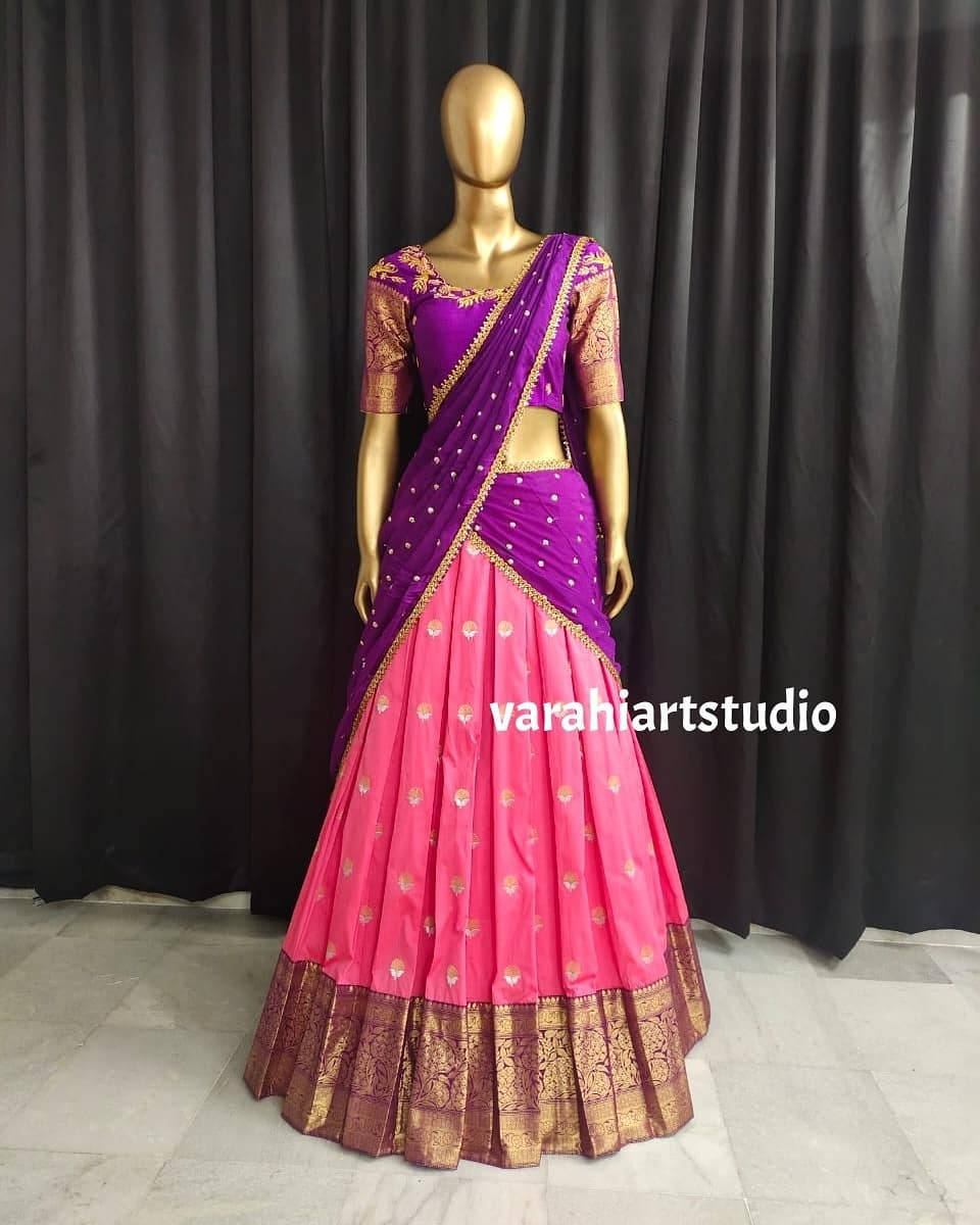 Stunning pink color pattu lehenga and purple blouse with net dupatta. Blouse with hand embroidery aari work.  2021-09-12