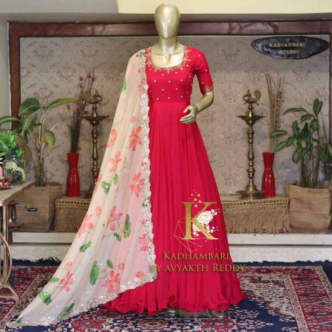Gorgeous red color floor length long frock with floral dupatta. Long frock with gold thread and bead maggam work on neckline.   2021-09-12