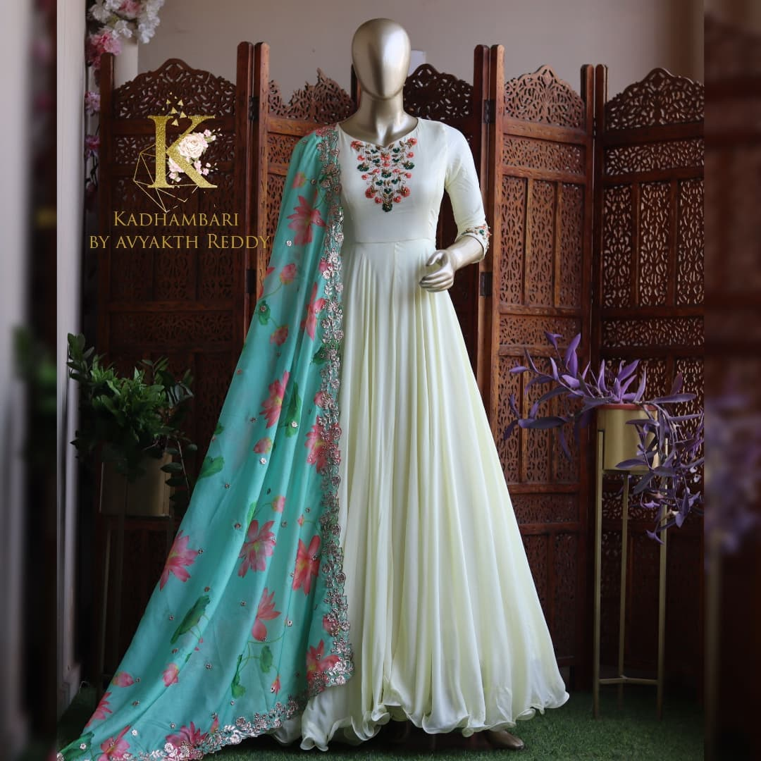 Gorgeous pearl white color floor length long frock with floral dupatta. Long frock with hand embroidery thread work on yoke.   2021-09-12