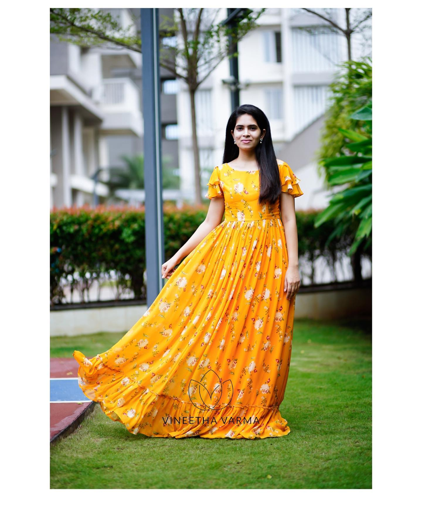 Beautiful Yellow georgete floral maxi with layered sleeves and frills. 2021-09-13