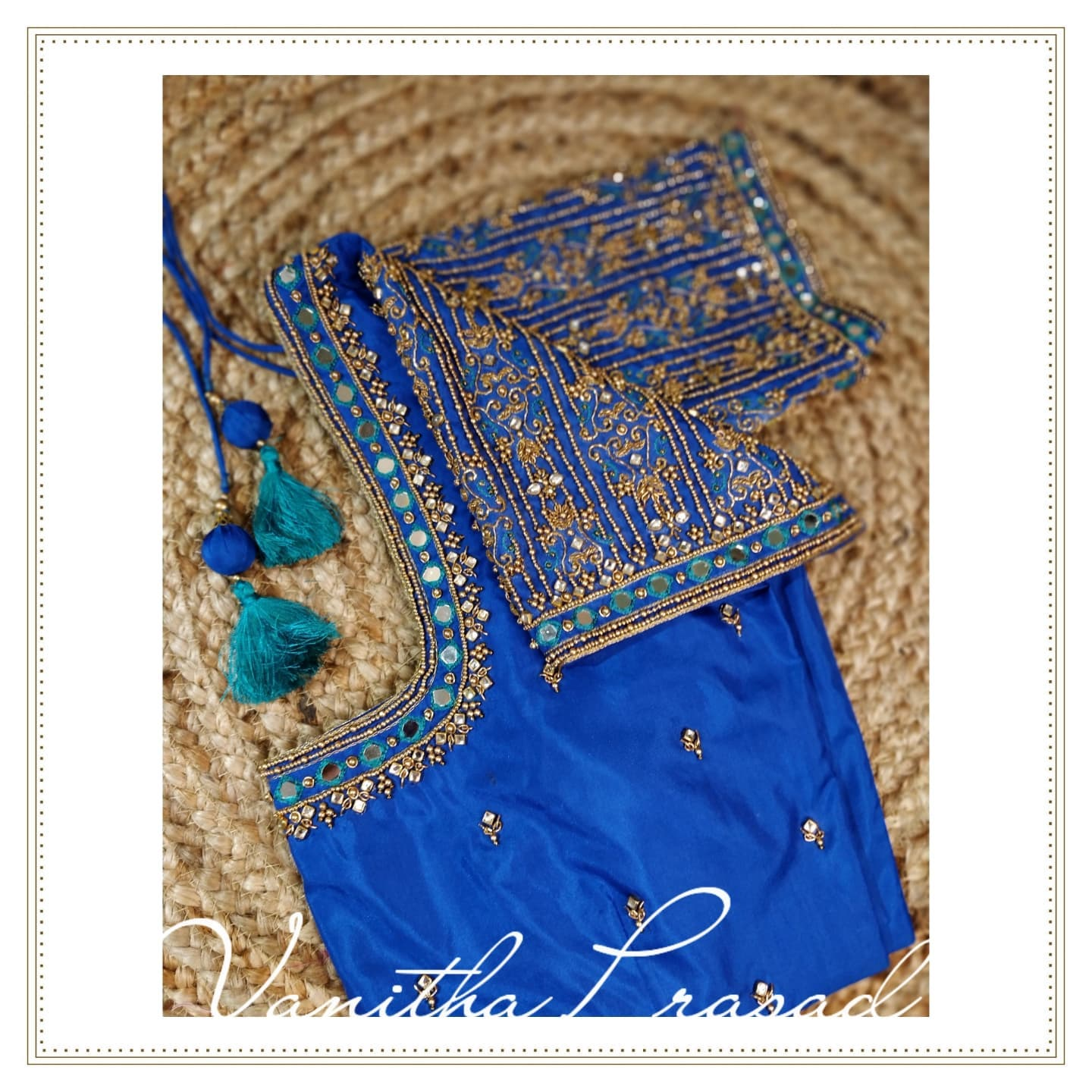Mirror embellished symmetric linear embroidery design. Stunning blue color blouse with mirror and bead aariwork. 2021-09-13