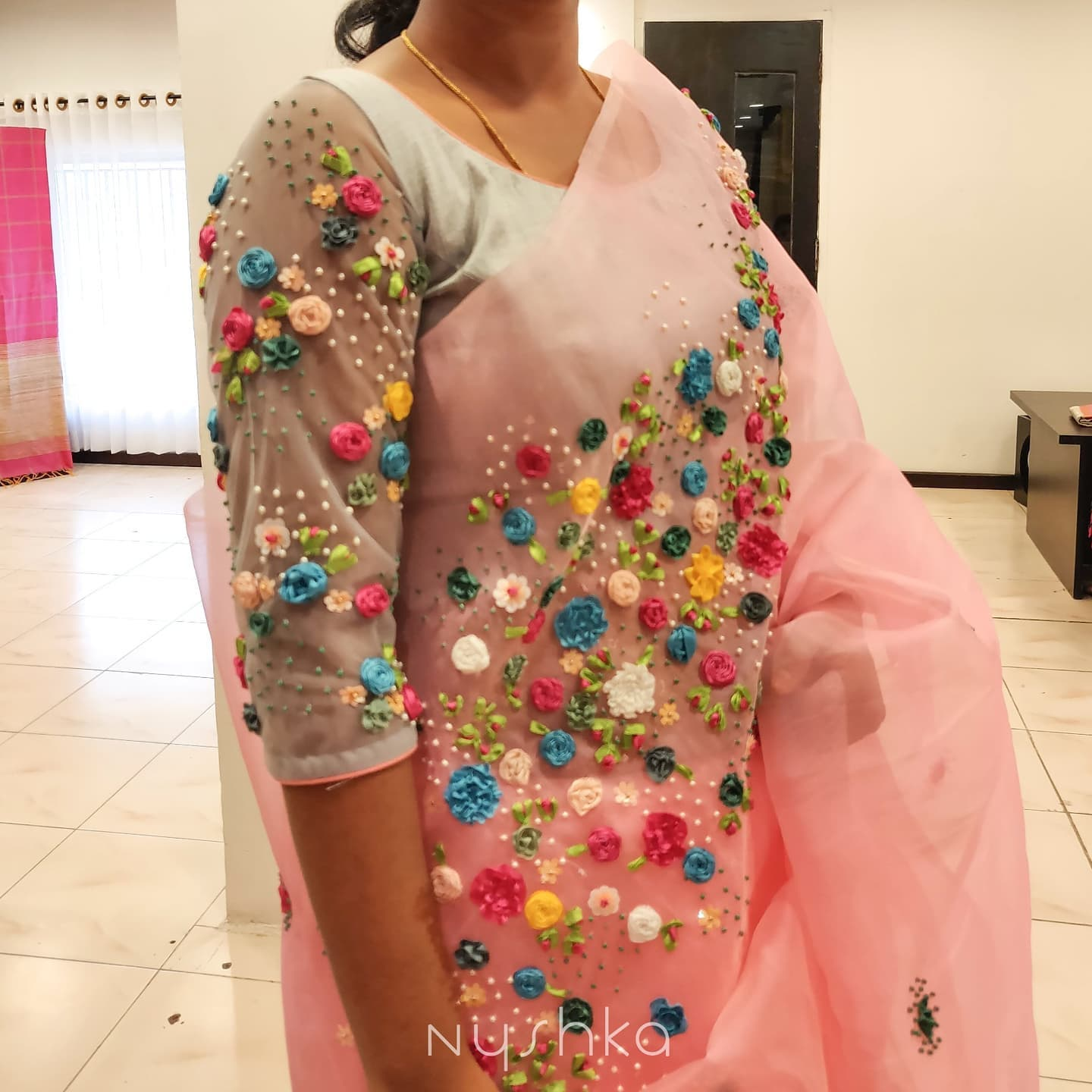 Gorgeous blush pink color saree and blouse with classy multi color thread embroidery work.  2021-09-13