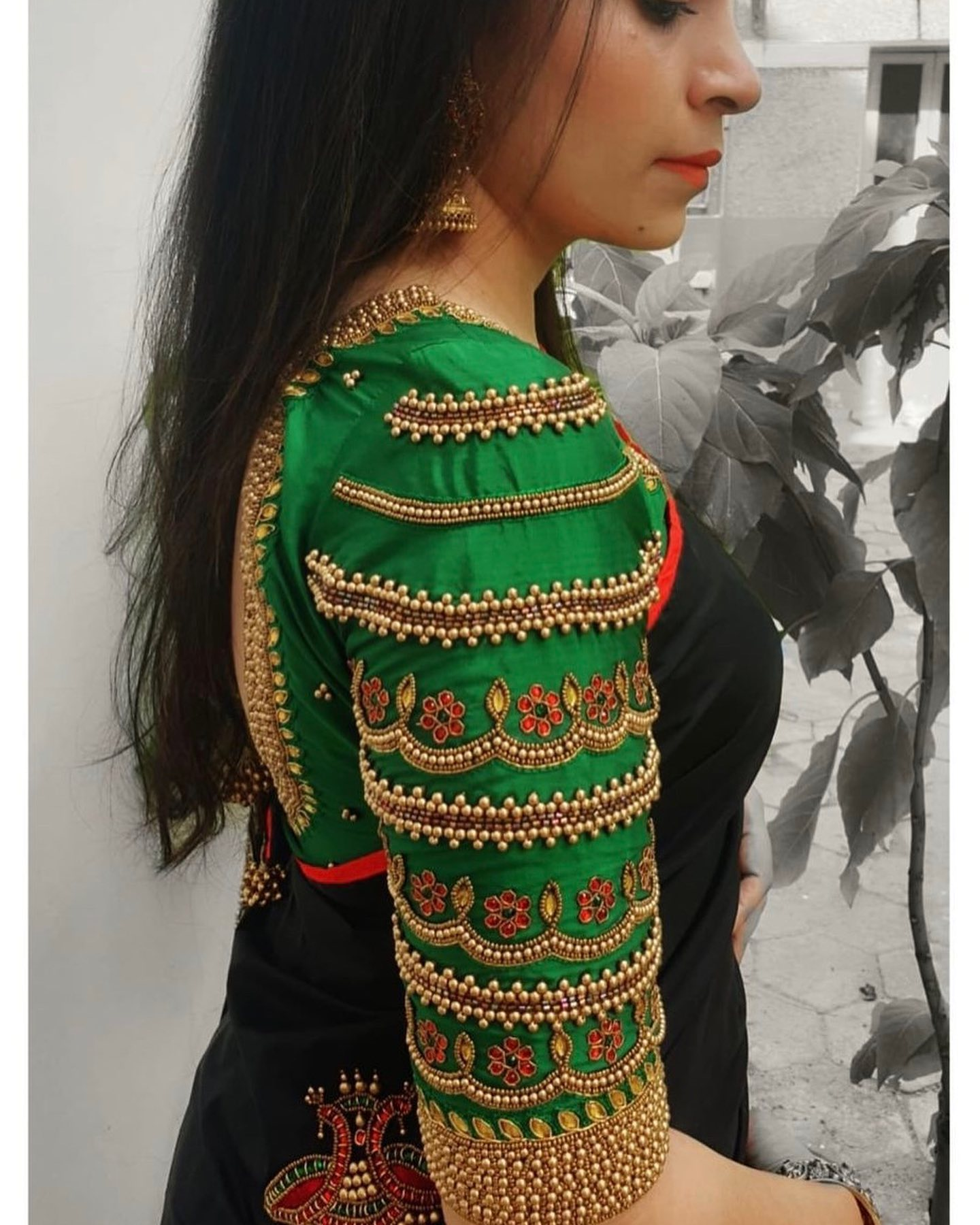 Stunning green color bridal blouse sleeve with bead and stone aari work. 2021-09-13