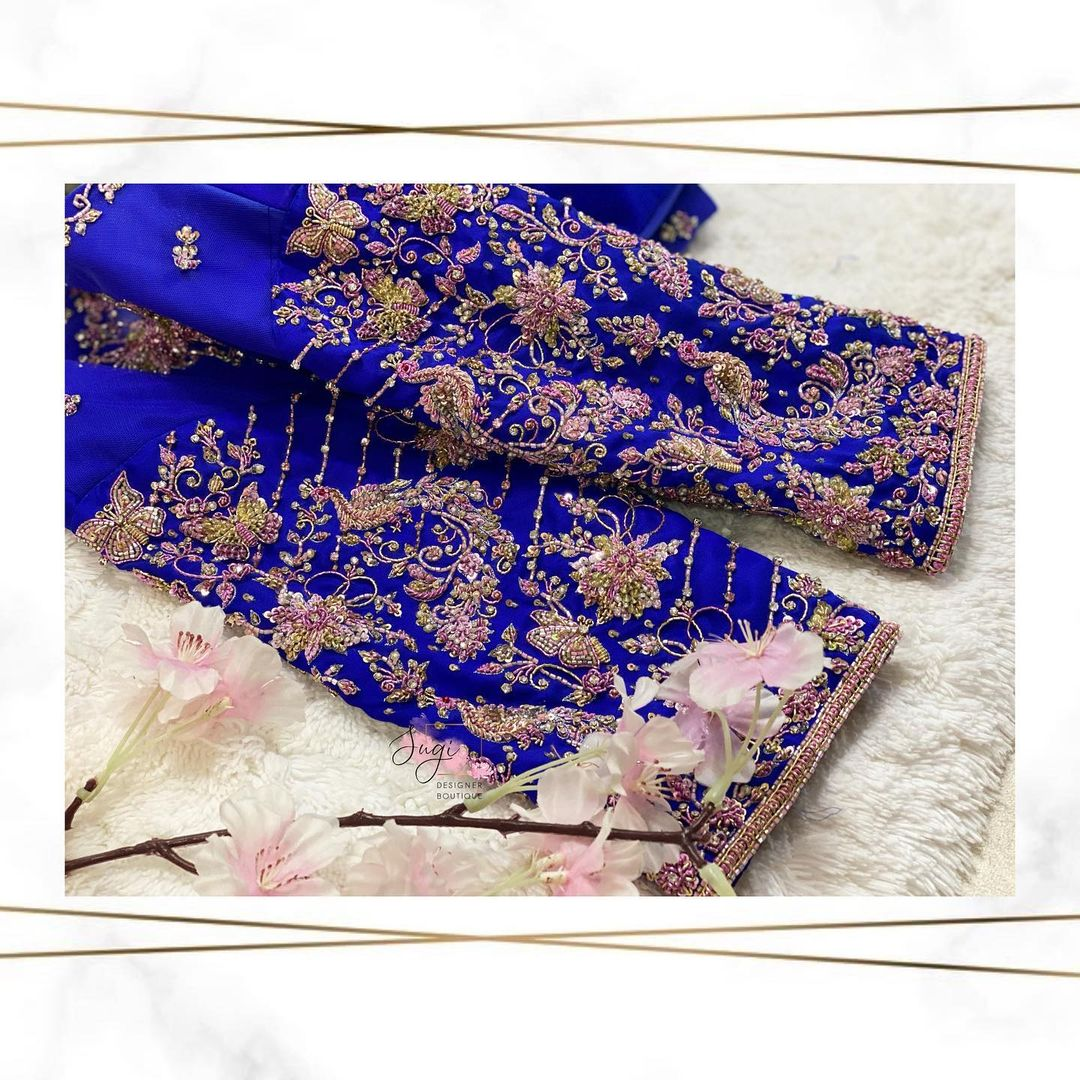 Stunning royal blue color bridal blouse with peacock hand embroidery silver thread zardosi work.  2021-09-13