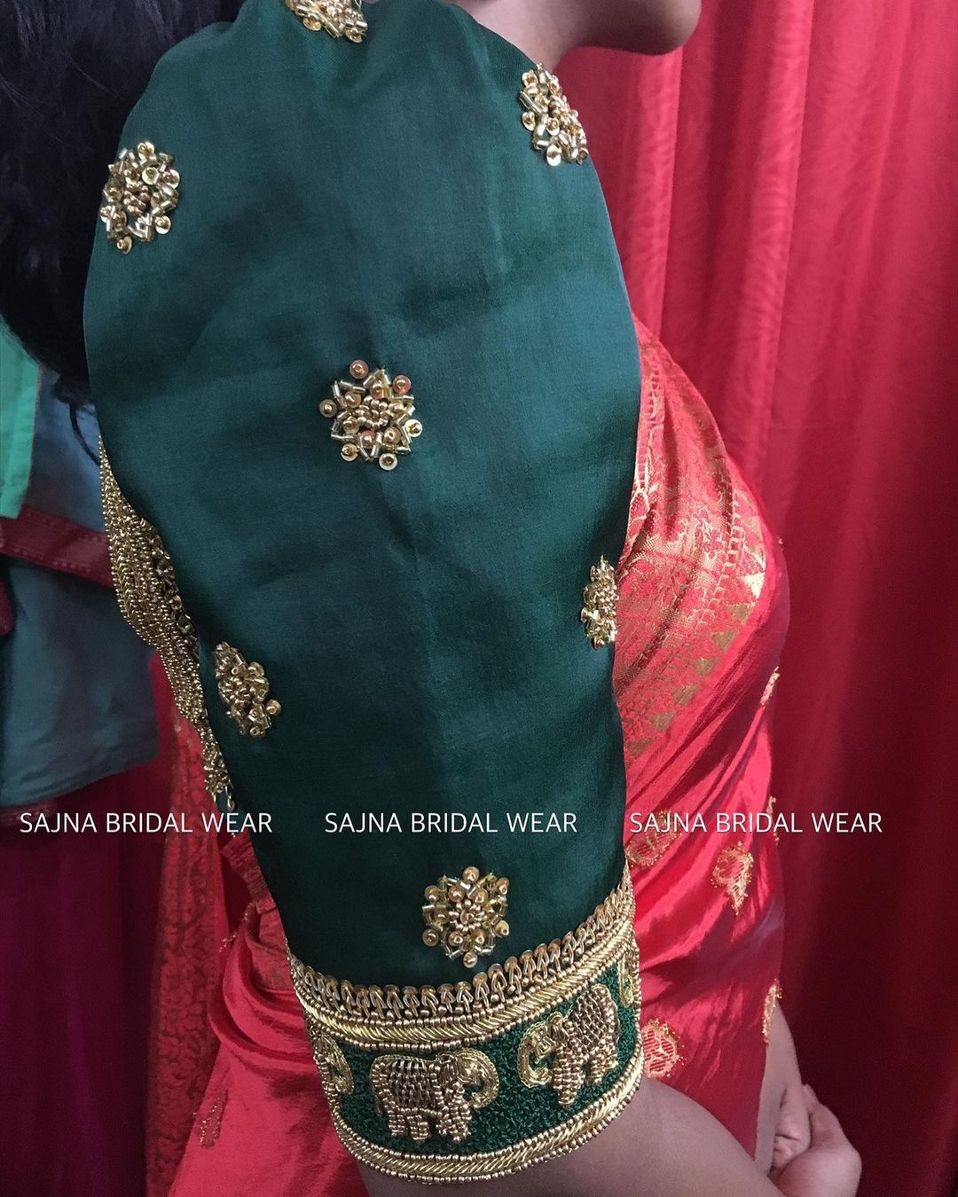 Gorgeous emerald green bridal blouse sleeve with elephant hand embroidery bead aari work on sleeves.  2021-09-13