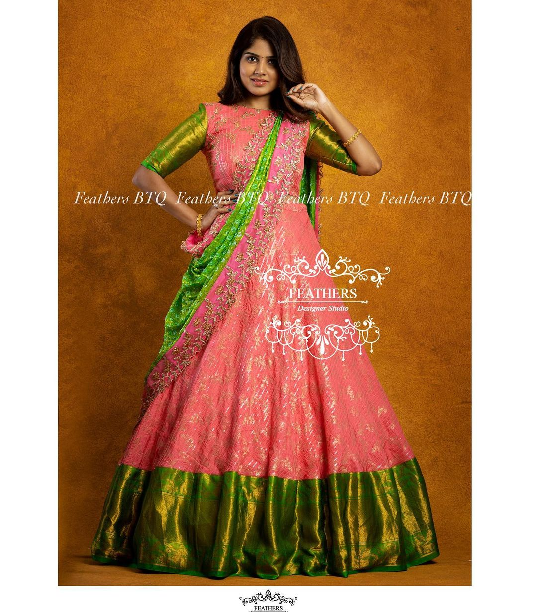 Traditional color combination blush pink and parrot green pattu lehenga and blouse with dupatta. Blouse with classy hand embroidery work.  2021-09-13