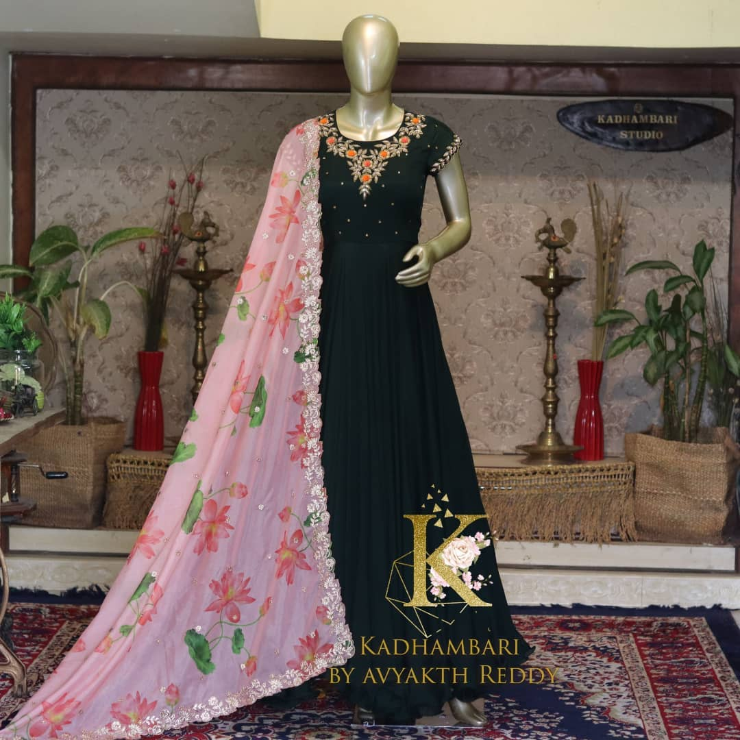 Stunning bottle green color floor length long frock with floral cut work dupatta. Long frock with hand embroidery work on yoke.  2021-09-13