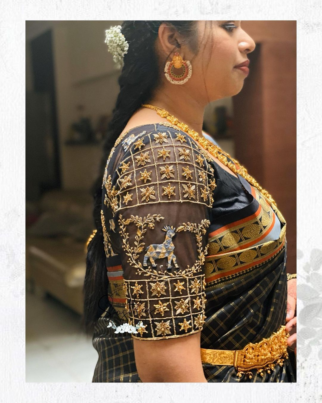 Stunning black color bridal blouse sheer sleeve with deer ahdne embroidery gold thread and stone maggam work.  2021-09-13