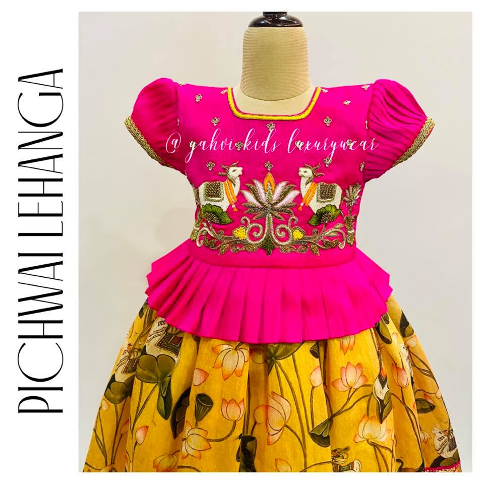 """"""" PICHWAI LEHANGA """" Loving this details and colours . Limited edition grab soon . Beautiful yellow kids kanchi pattu lehenga and long blouse.. Long blouse with cow hand embroidery work on yoke.  . For orders : DM or whatsapp 7893037777( messages only  no calls plz )  2021-09-14"""