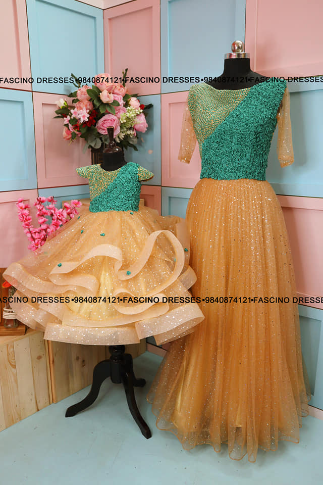 Golden shimmer gown with peacock color handcrafted bodice embellished with tiny flowers.. A classy creation from #Fascino . Wats app or inbox to order 9840874121 Can customize in any color / size 2021-09-14