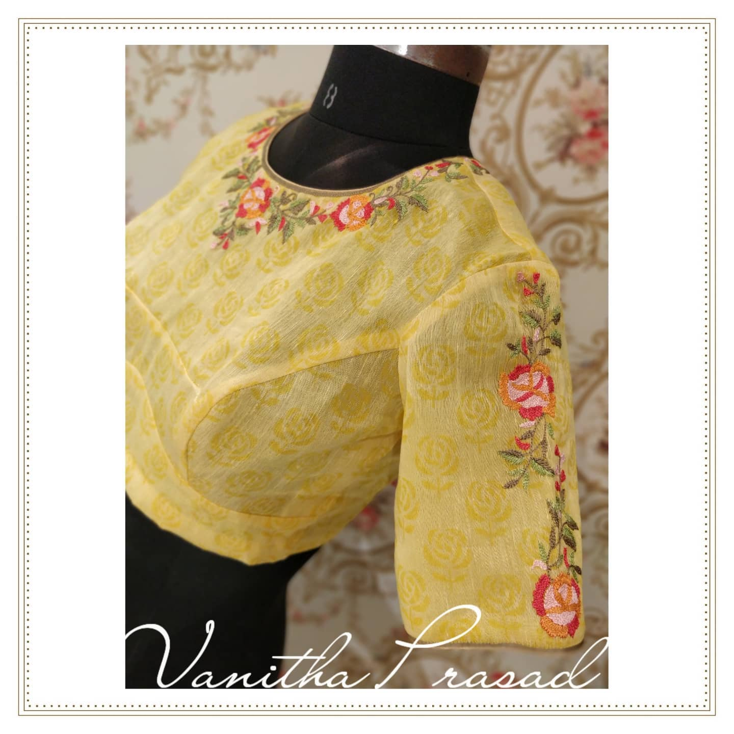Simple hand embroidered high neck blouse design with floral and creeper hand embroidery thread maggam work on neckline and sleeves.  2021-09-14
