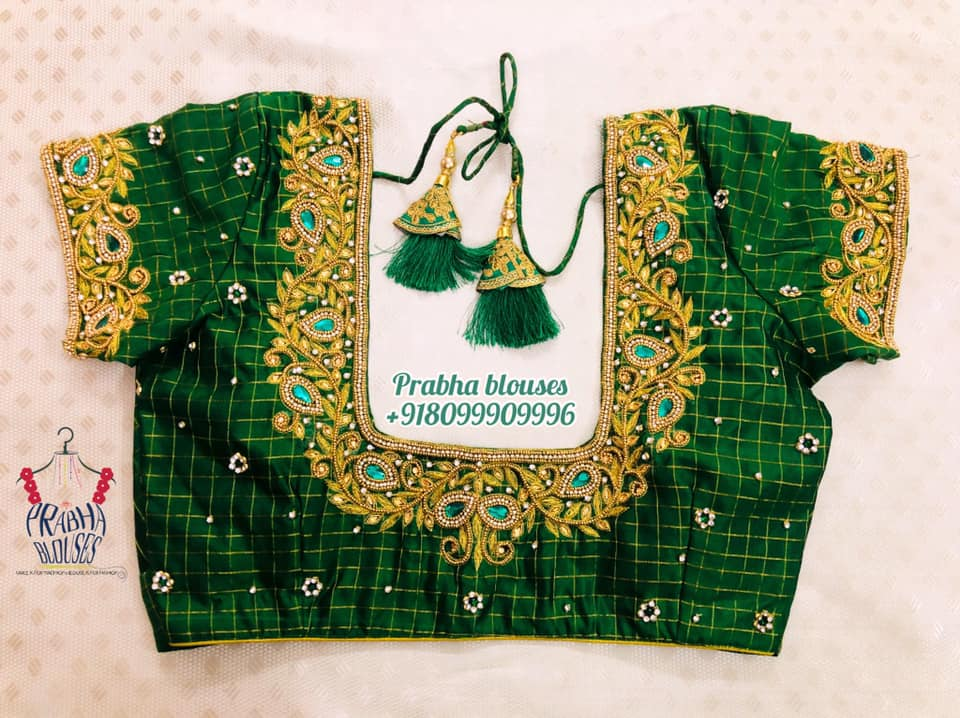 Gorgeous green color checked bridal blouse with floral and creeper hand embroidery bead gold thread and stone heavy maggam work.  2021-09-14