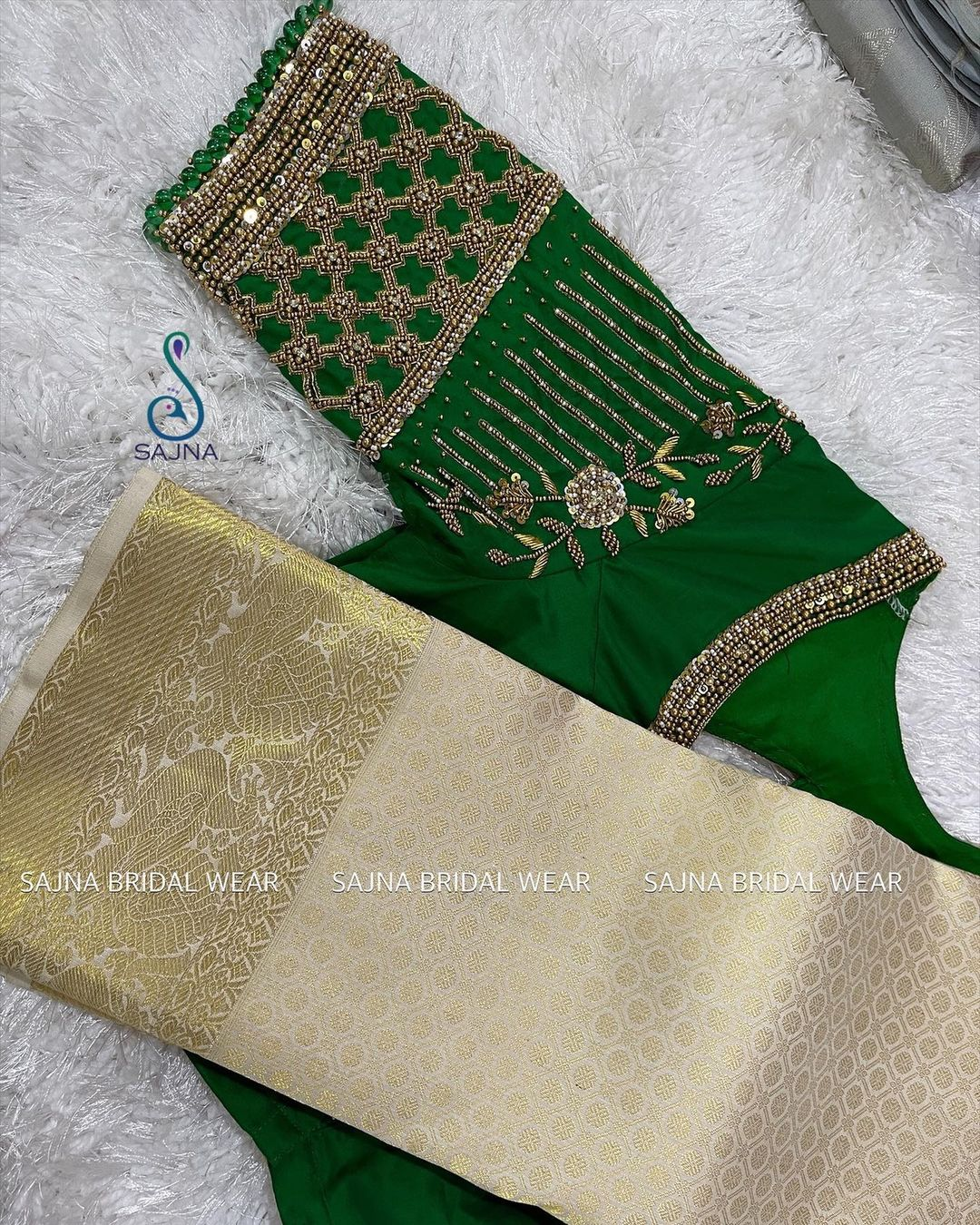Stunning green color princess cut bridal blouse with floral hand embroidery silver thread and stone zardosi work.  2021-09-14