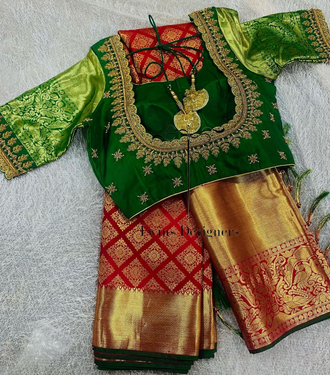 Pure kanjeevaram saree paired with contrast handmade work blouse
