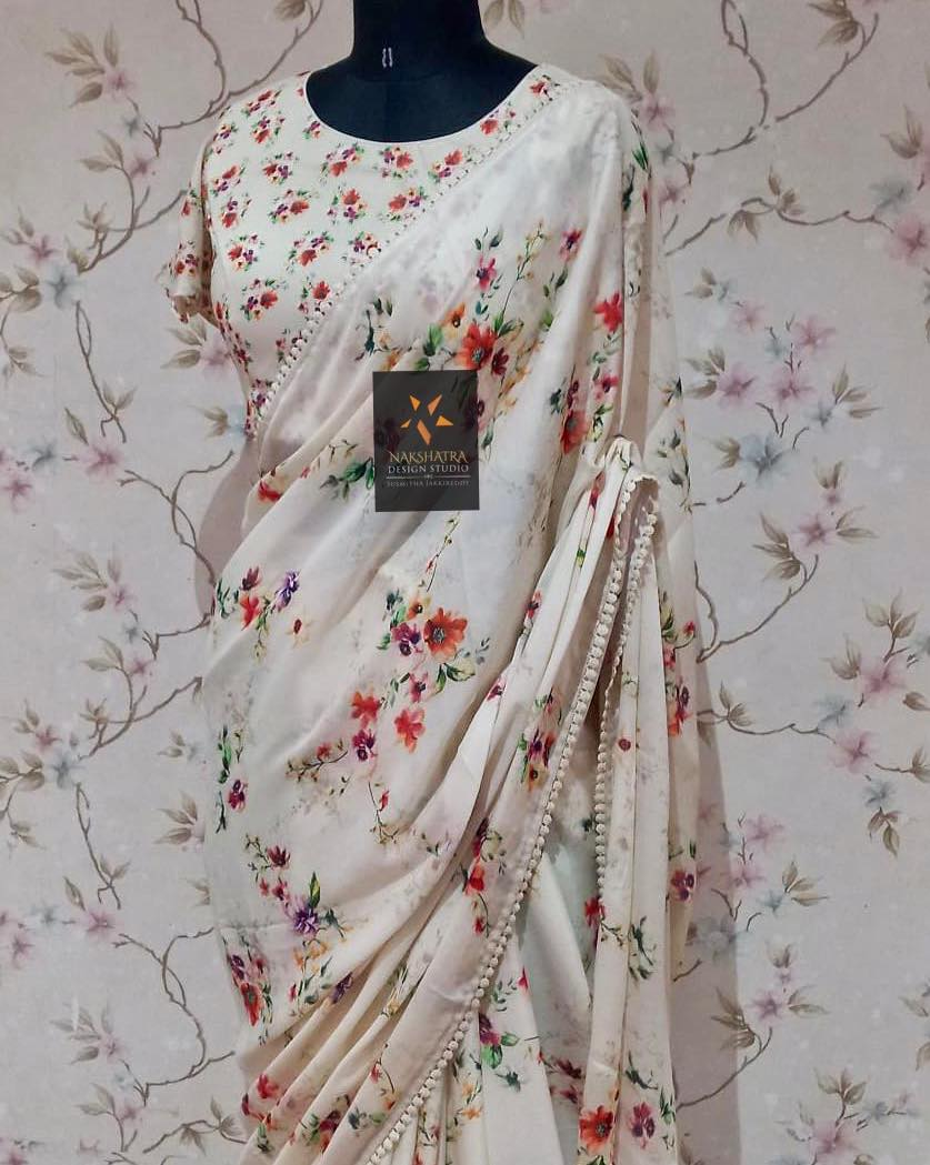 Pure gorgette floral  saree hemlined with cute lace  paired with floral ruffle sleeved blouse . 2021-09-15
