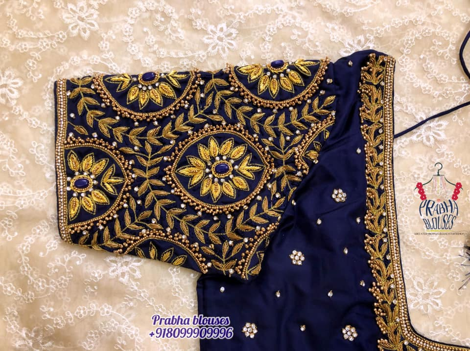 Beautiful deep blue color bridal blouse with floral gold thread and stone maggam work. 2021-09-15
