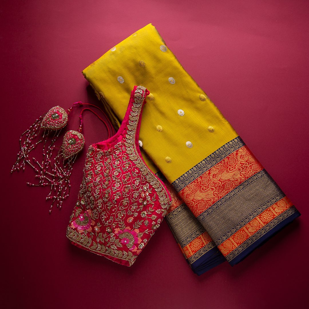 With uplifted yellow tone this Kanchipuram silk saree is supremely graceful. Enhanced with zari buttas all over the body with exquisite contrast border and pallu crafted in mythical motifs is a completely celebratory ensemble.  - Worldwide free shipping Contact : 00919845922959 Email: Esales@samyakk.com Product Code: SG1079. 2021-09-15