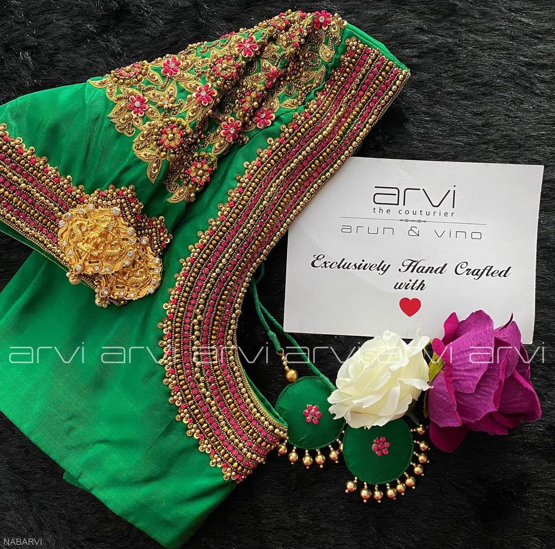 Stunning green color bridal blouse with floral zardosi work on shoulders and neckline. 2021-09-15